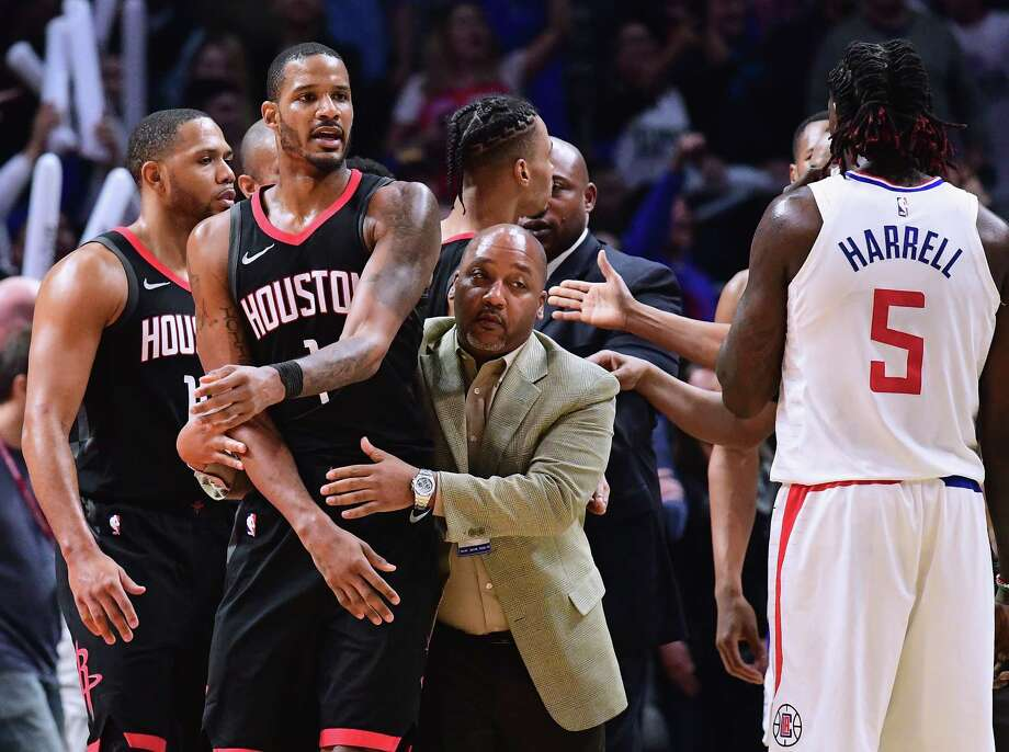 LOS ANGELES, CA - JANUARY 15:  Trevor Ariza #1 of the Houston Rockets is restrained by an assistant coach before his ejection from the game during a 113-102 LA Clippers win at Staples Center on January 15, 2018 in Los Angeles, California.  (Photo by Harry How/Getty Images)For the key moments that sparked Monday's confrontation, browse through the slideshow. Photo: Harry How, Staff / 2018 Getty Images