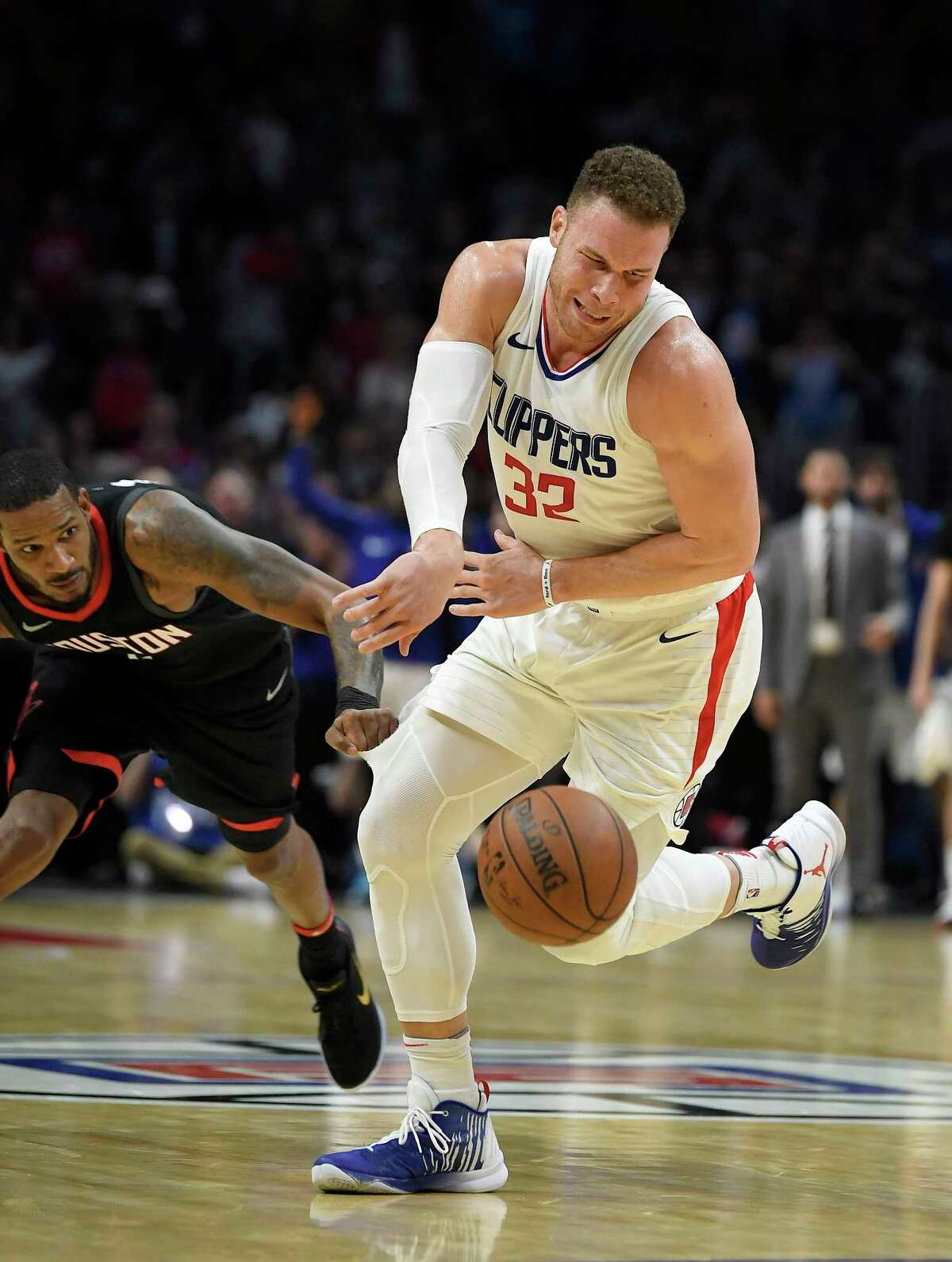 Houston Rockets forward Trevor Ariza, left, pulls and rips the uniform of Los Angeles Clippers forward Blake Griffin during the second half of an NBA basketball game, Monday, Jan. 15, 2018, in Los Angeles. The Clippers won 113-102. (AP Photo/Mark J. Terrill)