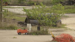 A child's toy sits inside the MDI superfund site. Despite a fence surounding the 36 acre site, children still slip pass the warning signs to roam through the forbidden area,  Thursday April 8, 2004.. The residents living around the MDI superfund site are processing the latest news that the EPA has no funds to finish cleaning up the contaminated area just northeast of downtown Houston. The Museum of Cultural Arts Houston, MOCAH,   Project Grow will hang student painted murals around the 36 acre site for Earth Day, April 24. Chronicle/Ben DeSoto