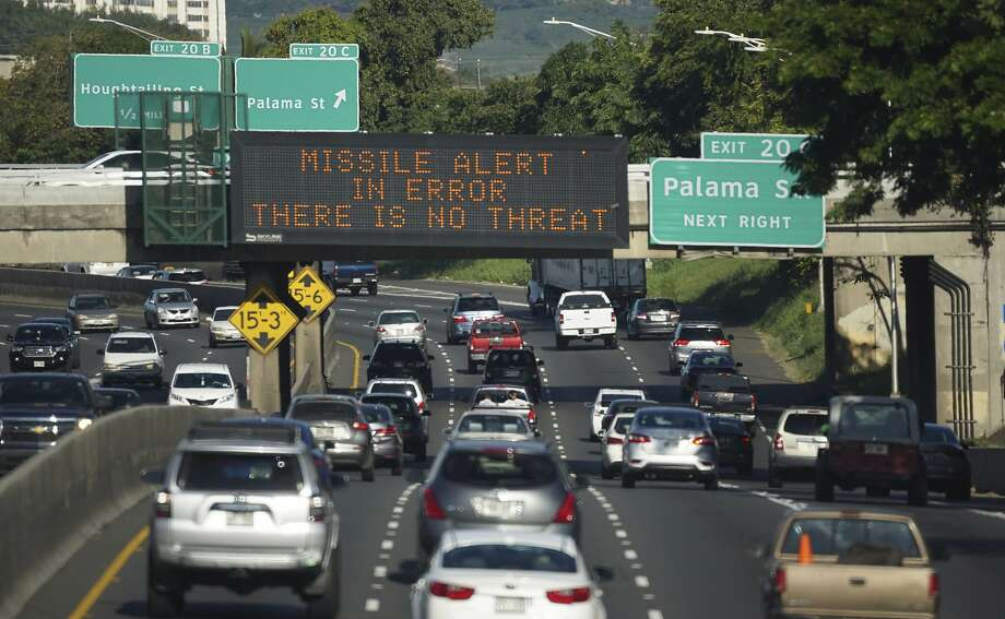 A highway sign in Honolulu indicates the missile alert on Saturday was an error. Sending a false alert is more difficult in California, officials say. Photo: Cory Lum, Associated Press