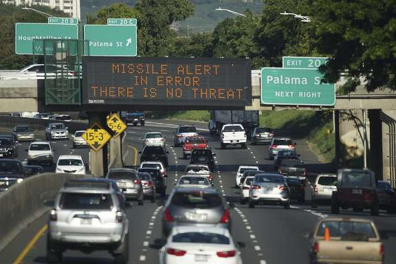 "FILE - In this Saturday, Jan. 13, 2018 file photo provided by Civil Beat, cars drive past a highway sign that says ""MISSILE ALERT ERROR THERE IS NO THREAT"" on the H-1 Freeway in Honolulu. Gov. David Ige has appointed state Army National Guard Brig. Gen. Kenneth Hara as new head of Hawaii's emergency management agency after a faulty alert was sent to cellphones around the state warning of an incoming missile attack. (Cory Lum/Civil Beat via AP, file)"