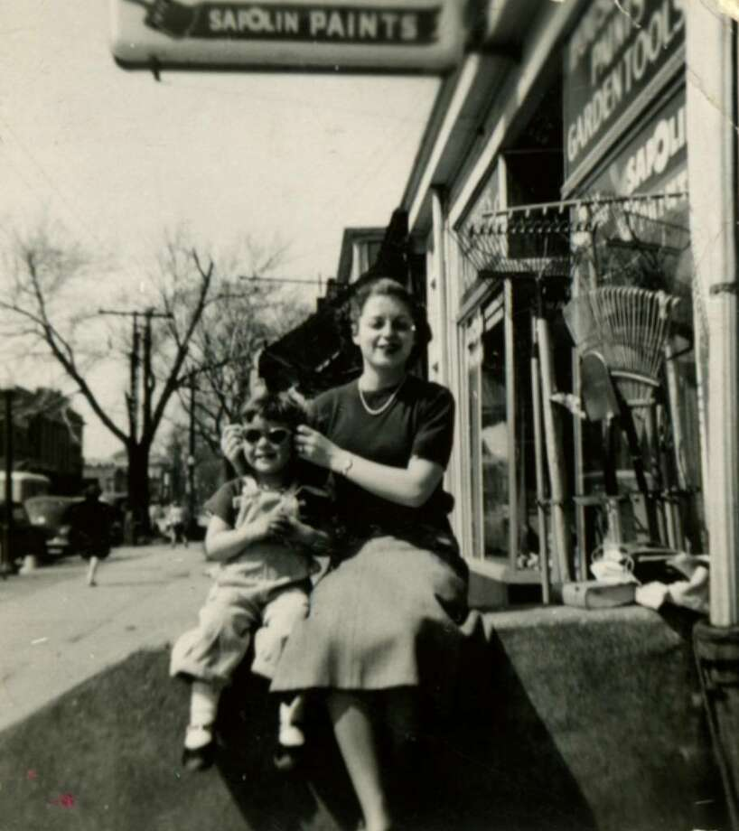 Marcia Goldstein with her sister Betty at their home on Madison Ave., where the famly lived above their store, a card and souvenir gift shop called Princly's.