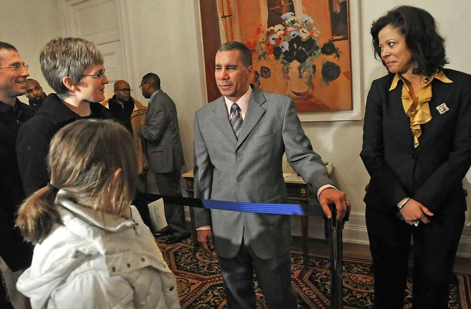 From left, the DeCesare family, Carl, Anne and Emily, age 10, from Niskayuna, meet Gov. David Paterson and his wife, Michelle Paige Paterson, as the state's first family opens the doors of the Executive Mansion to the public on New Year's Day.  (Lori Van Buren / Times Union) Photo: LORI VAN BUREN