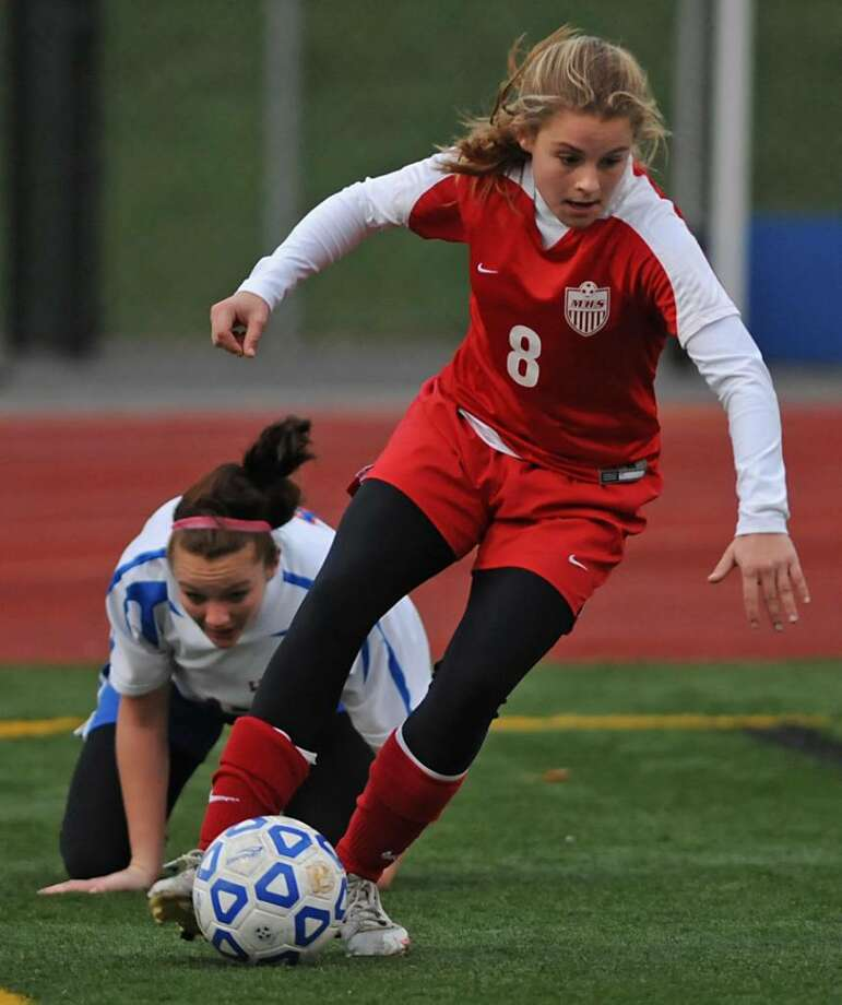 Abby Maiello, taking the ball away from  a Livonia player in the corner during the state Class B girls' soccer semifinal in Homer, was a key scoring threat for Mechanicville this season.  (Lori Van Buren / Times Union) Photo: LORI VAN BUREN / 00006442A