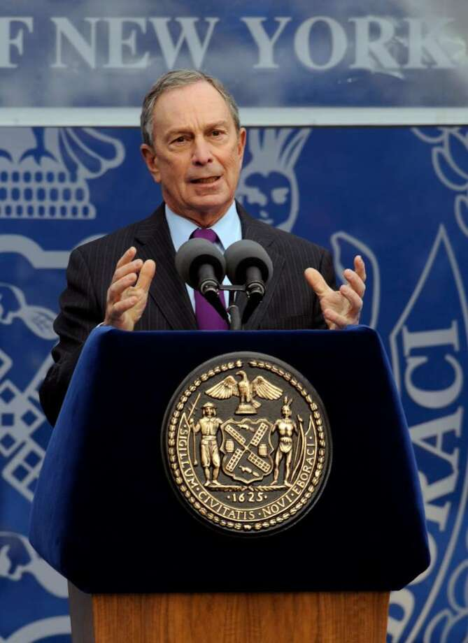 New York City Mayor Michael Bloomberg delivers his acceptance speech after being sworn in for a third term on the steps of City Hall in New York, Friday, Jan. 1, 2010. (AP Photo/Henny Ray Abrams) Photo: Henny Ray Abrams / FR151332 AP