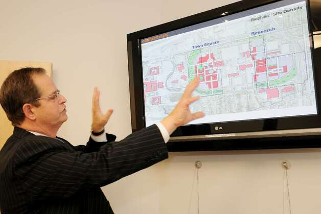 Howard Carr, president of The Howard Group, shows a computer rendering of space his company has proposed for long-term development to create new uses and spaces on the Harriman Campus, on Monday, Nov. 30 in Albany at his office. The Howard Group's proposal was not chosen and Carr wants to know why.  (Luanne M. Ferris / Times Union) Photo: LUANNE M. FERRIS