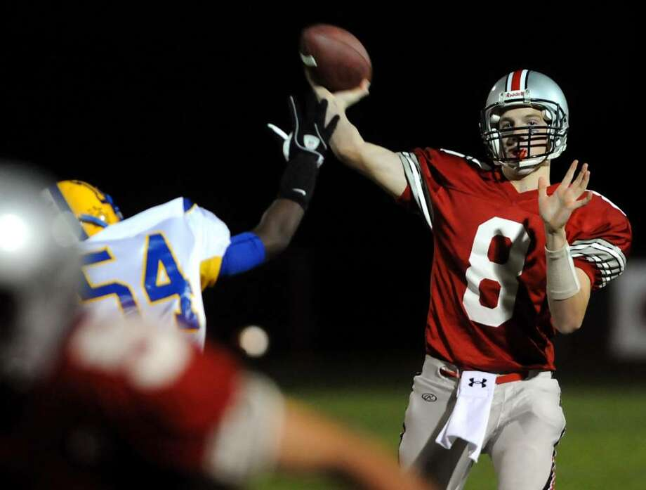 Niskayuna quarterback Kyle Bayly, right, releases a pass against Bishop Maginn. (Cindy Schultz / Times Union) Photo: CINDY SCHULTZ