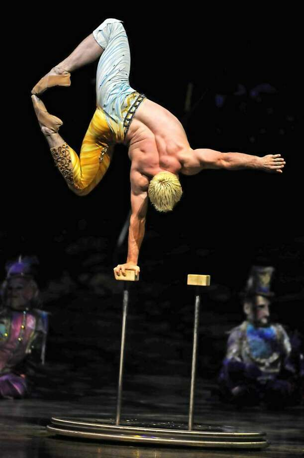 """A performer in the Cirque Du Soliel's """"Alegria"""" does the hand balancing act for an audience at the Times Union Center in Albany, NY on Wednesday September 2, 2009. (Lori Van Buren / Times Union) Photo: LORI VAN BUREN"""
