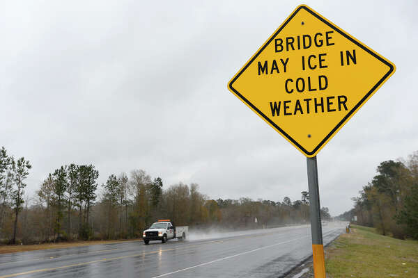 A sign warns motorists to drive carefully on the bridge over Pine Island Bayou on Texas 105 on Tuesday.  Photo taken Tuesday 1/16/18 Ryan Pelham/The Enterprise