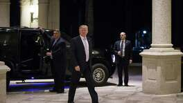 President Donald Trump arrives for dinner at Trump International Golf Club, in West Palm Beach, Fla., Sunday. Trump told reporters outside the club, I'm not a racist. I'm the least racist person you will ever interview, that I can tell you, and insisted that the derogatory comment attributed to him during an Oval Office meeting on immigration last week did not occur.