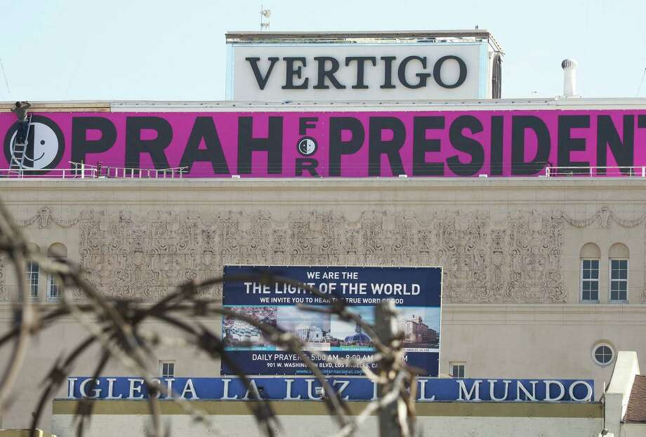 "A sign reading ""Oprah For President"" is seen atop a building in downtown Los Angeles Friday. As with a previous inexperienced person from Illinois who went on to become president, Winfrey's ability to be elected is being underestimated. Photo: ROBYN BECK /AFP /Getty Images / AFP or licensors"