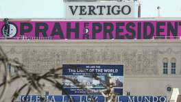 "A sign reading ""Oprah For President"" is seen atop a building in downtown Los Angeles Friday. As with a previous inexperienced person from Illinois who went on to become president, Winfrey's ability to be elected is being underestimated."