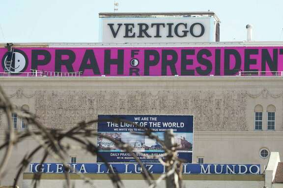 """A sign reading """"Oprah For President"""" is seen atop a building in downtown Los Angeles Friday. As with a previous inexperienced person from Illinois who went on to become president, Winfrey's ability to be elected is being underestimated."""
