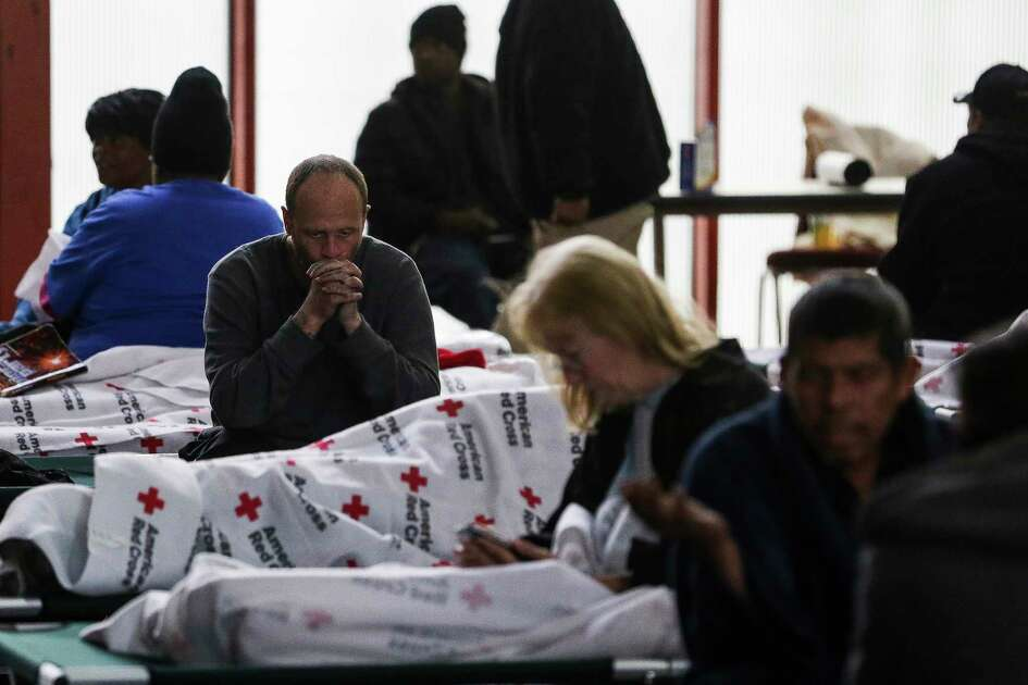 Jeremy Roberts sits on a cot at a warming shelter opened by the Harris County Precinct One Constables Office and the American Red Cross at Pleasant Grove Missionary Baptist Church as freezing weather moves through the region Tuesday, Jan. 16, 2018 in Houston.