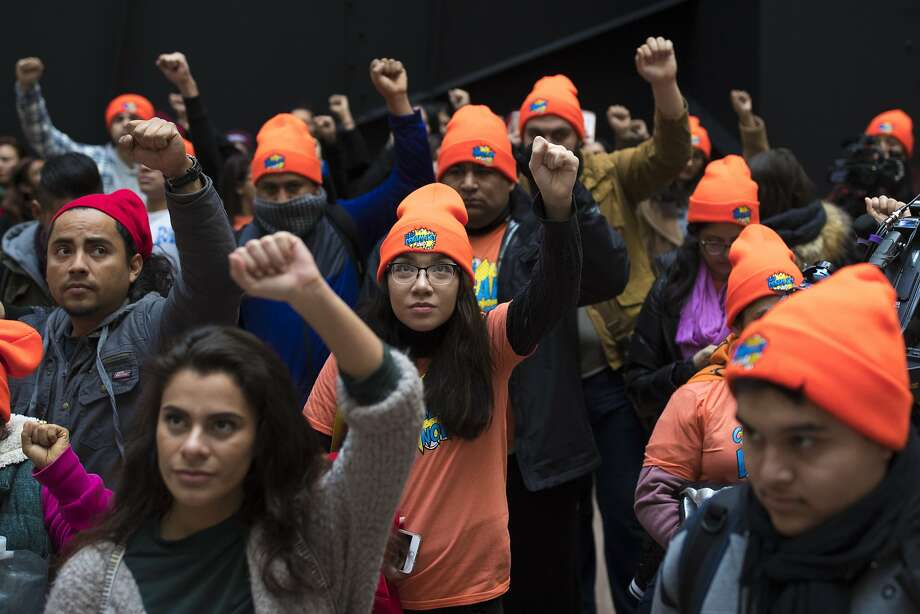 Protesters demonstrate over the fate of the Deferred Action for Childhood Arrivals program, on Capitol Hill in Washington, Jan. 16, 2018. President Donald TrumpÕs incendiary words about immigration have dampened the prospects that a broad spending and immigration deal can be reached by the end of the week, raising the possibility of a government shutdown. (Tom Brenner/The New York Times) Photo: TOM BRENNER, NYT