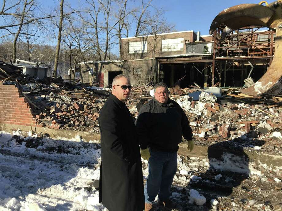 Derby Mayor Richard Dziekan confers with Frank Pepe of F. Pepe Construction during the Jan. 10 demolition of a building at 150 Roosevelt Drive. Photo: /
