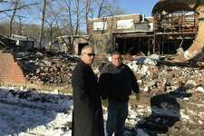 Derby Mayor Richard Dziekan confers with Frank Pepe of F. Pepe Construction during the Jan. 10 demolition of a building at 150 Roosevelt Drive.