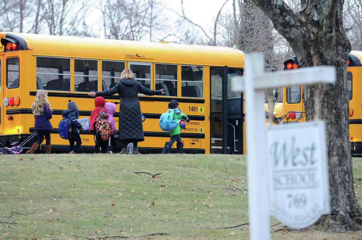 Students leave West Elementary School in New Canaan on Tuesday, Jan. 16, 2018. 10-year-old Nico Mallozzi, who died from a flu associated illness on Sunday, attended West Elementary.