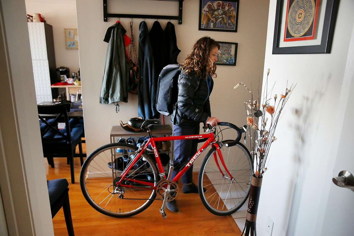 Shayanne Martin leaves for work with her bicycle, which was stolen and returned to her by a woman who spotted it being ridden after seeing it posted on Bike Index, on Wednesday, December 6, 2017 in San Francisco, Calif.