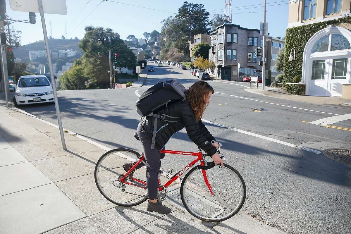 Shayanne Martin rides her bike as she commutes to work on it for the first time after it was stolen and returned to her on Wednesday, December 6, 2017 in San Francisco, Calif. Martin's bicycle which was stolen and returned to her by a woman who spotted it being ridden after seeing it posted on Bike Index . Shayanne is a serious helmet advocate and her helmet was stolen with the bike.