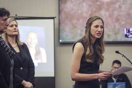 CORRECTS LAST NAME TO STEPHENS INSTEAD OF STEVENS - Former family friend to the Nassar family, and babysitter to Nassar's children Kyle Stephens, right, addresses Larry Nassar Tuesday, Jan. 16, 2018, during the first day of the victim impact statements addressing the former sports medicine doctor  in Circuit Court Rosemarie Aquilina's courtroom in Lansing, Mich. Behind Stephens is her mother, and Asst. Prosecutor Angela Povilaitis, center. Nassar pleaded guilty to molesting females with his hands at his Michigan State University office, his home and a Lansing-area gymnastics club. (Matthew Dae Smith/Lansing State Journal via AP)