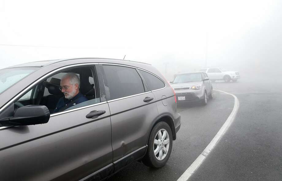 Robert Fyles of S.F. tries to purchase a permit from his car on Panoramic Highway. Photo: Paul Chinn, The Chronicle