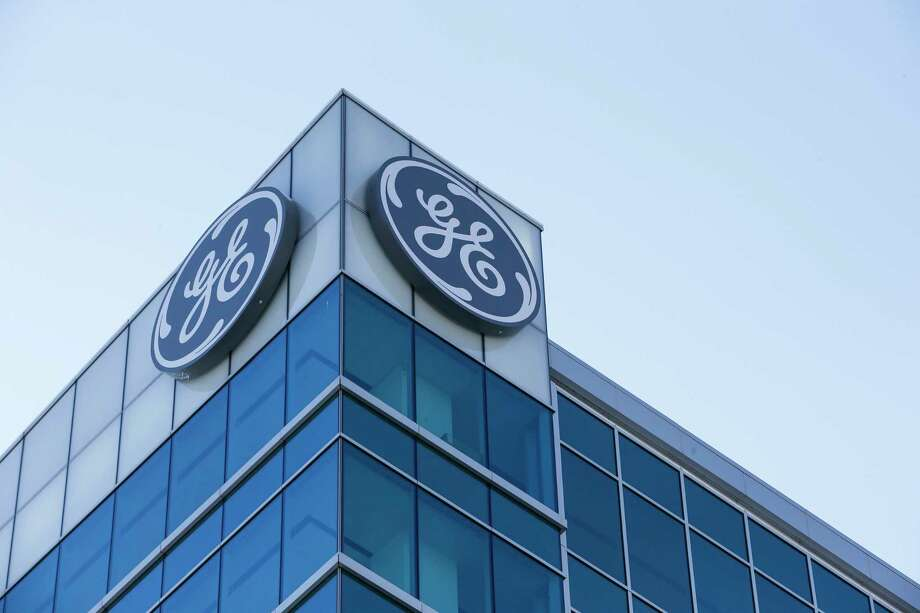 The General Electric logo is displayed at the top of their Global Operations Center, Tuesday, Jan. 16, 2018, in the Banks development of downtown Cincinnati. GE CEO John Flannery, who was put in charge of reviving the company last summer, revealed significant issues at GE Capital on Tuesday, which will lead to a $6.2 billion after-tax charge in the fourth quarter. (AP Photo/John Minchillo) Photo: John Minchillo, STF / AP
