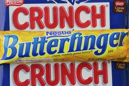 Swiss food and drink giant Nestle is selling its U.S. candy business to Italy's Ferrero for about $2.8 billion in cash. Ferrero will take over iconic chocolate brands Butterfinger and Crunch bars, as well as the sugary Nerds, SweeTarts and FunDip. The deal is expected to close at the end of the first quarter of 2018. (AP Photo/Mark Lennihan, File)