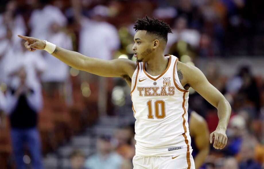 Texas guard Eric Davis Jr. (10) signals to teammates during the first half of an NCAA college basketball game against TCU , Wednesday, Jan. 10, 2018, in Austin, Texas. Photo: Eric Gay /AP Photo