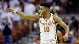 Texas guard Eric Davis Jr. (10) signals to teammates during the first half of an NCAA college basketball game against TCU , Wednesday, Jan. 10, 2018, in Austin, Texas.