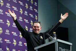 Minnesota Vikings head coach Mike Zimmer waves as fans looked into his post-game press conference following a 29-24 win over the New Orleans Saints an NFL divisional football playoff game in Minneapolis, Sunday, Jan. 14, 2018. (AP Photo/Jeff Roberson)