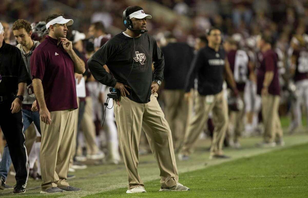 Texas A&M head coach Kevin Sumlin looks towards his team before a play during the second quarter of an NCAA college football game against New Mexico on Saturday, Nov. 11, 2017, in College Station, Texas. (AP Photo/Sam Craft)