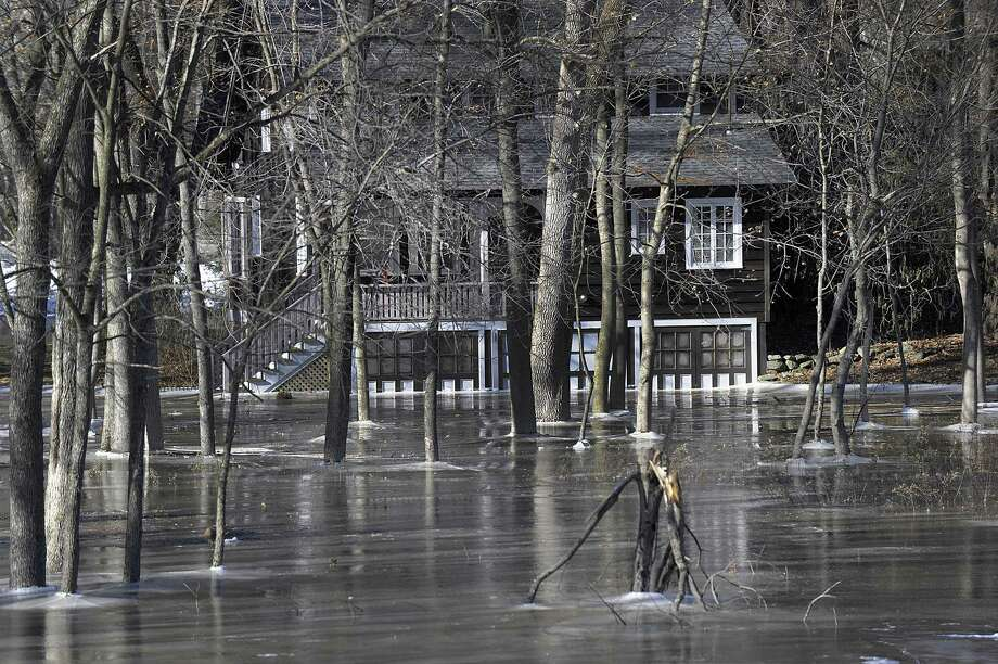 Frozen water overflowing from the Housatonic River in Kent reaches to some of the homes along Route 7 in Kent Sunday, January 14, 2018. Photo: Carol Kaliff / Hearst Connecticut Media / The News-Times