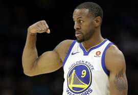 Golden State Warriors' Andre Iguodala (9) flexes his muscles in the second half of an NBA basketball game against the Cleveland Cavaliers, Monday, Jan. 15, 2018, in Cleveland. (AP Photo/Tony Dejak)