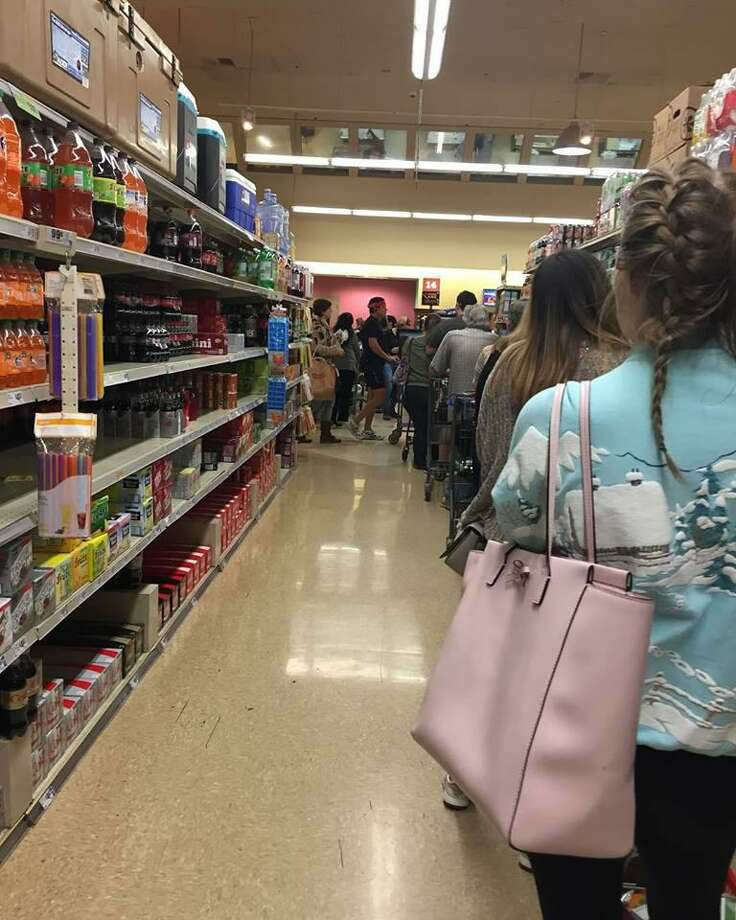 Shoppers lined up at the HEB in Lincoln Heights on Monday, Jan. 15 to stock up in advance of winter storm Inga, which shuttered most of the city Tuesday. Photo: Kate Gruy Jaceldo /Kate Gruy Jaceldo
