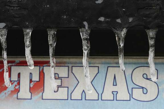 Icicles hang from the back of a car on Tuesday, Jan. 16, 2018. An overnight blast of Arctic air combined with precipitation shuttered most of the city on Tuesday. Motorists who ventured out encountered numerous accidents along the roads and icy overpasses.