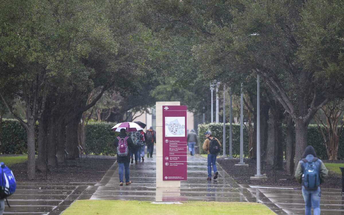 Texas A& International University students bundle up as they head to class on Tuesday, Jan. 16, 2018, as a strong cold front brings near freezing temperatures to South Texas.