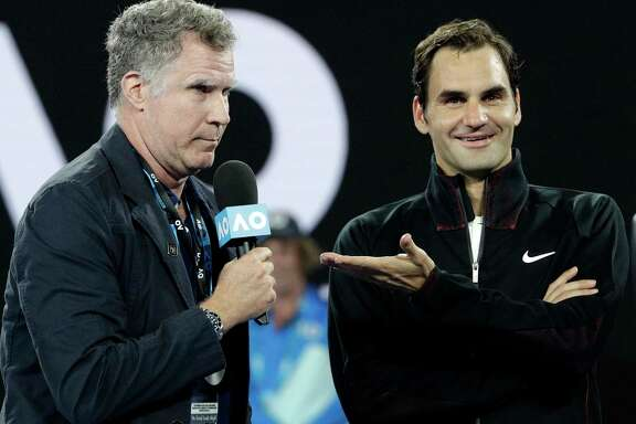 Ron Burgundy, aka Will Ferrell, conducts an interview with Roger Federer after his first-round victory Tuesday over Aljaz Bedene.