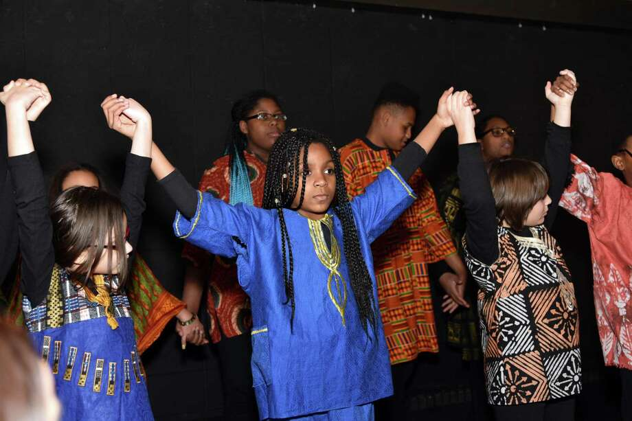 The Queen Ann Nzinga Center, Inc., which offers arts enrichment activities for children and teens ages 5 to 17, is accepting new participants for its programs and classes. Above, children take part in the center's recent Kwanzaa celebration. Photo: Contributed Photo
