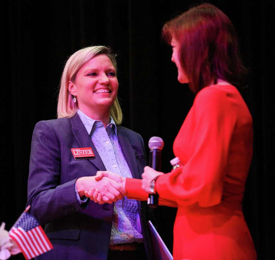 Jo Anne Linzer, left, and Kristin Bays, right, candidates for 284th District Court Judge, speaks during the Public Republican Candidate Forum hosted by Magnolia Area Republican Women on Monday, Jan. 15, 2018, at Magnolia Parkway Elementary. Photo: Michael Minasi, Staff Photographer / © 2017 Houston Chronicle