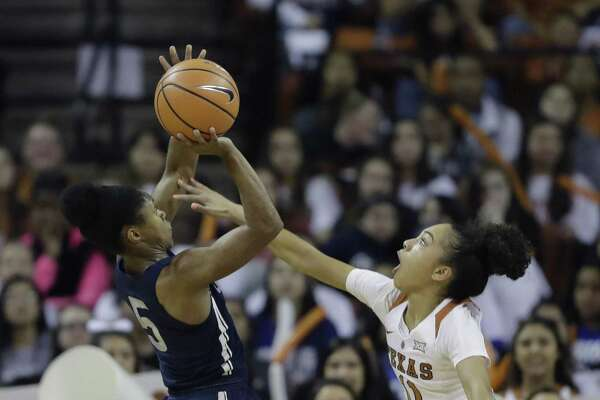 UConn guard Crystal Dangerfield (5) shoots over Texas guard Brooke McCarty (11) during the first half on Monday.