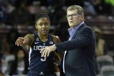 UConn head coach Geno Auriemma talks with guard Crystal Dangerfield during the first half on Saturday.