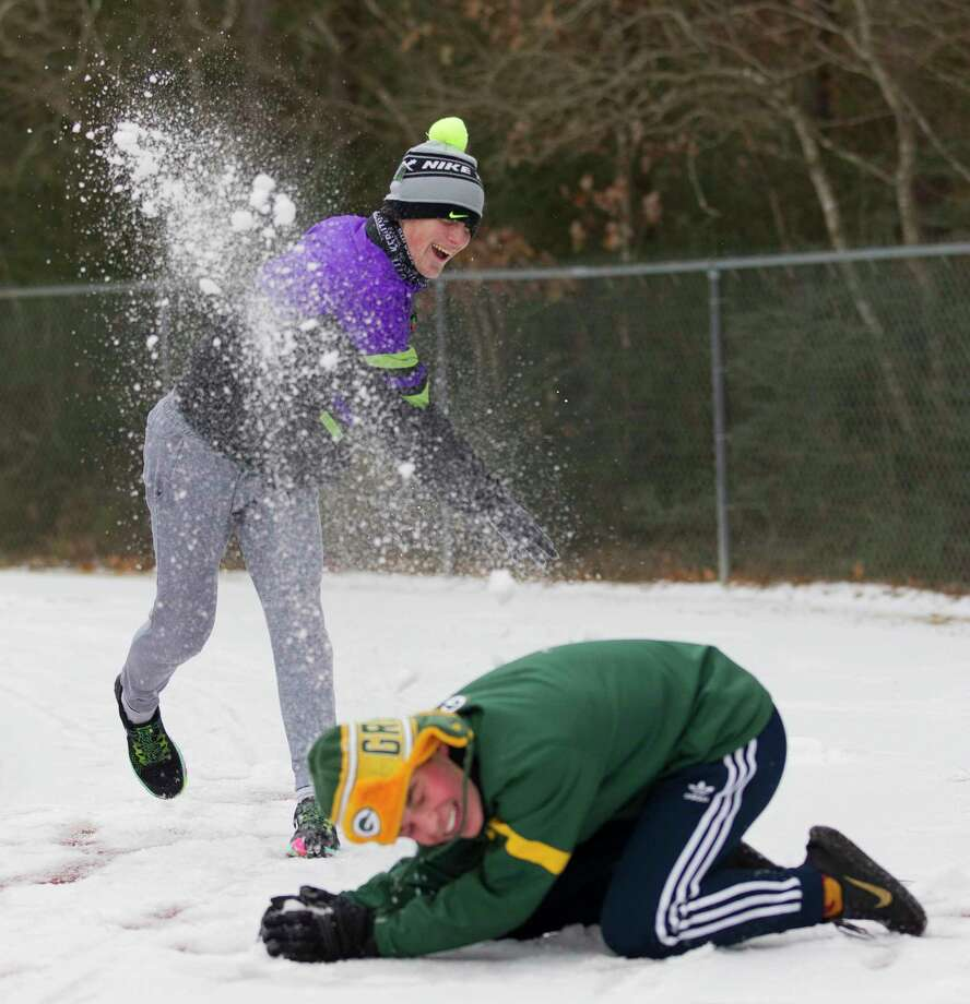 Trent Nolen throws a snowball at Evan Koach at Riverwood Middle School, Tuesday, Jan. 16, 2018, in Kingwood. The National Weather Service issued a Winter Storm Warning for southeast Texas until midnight Wednesday. Photo: Jason Fochtman, Staff Photographer / © 2018 Houston Chronicle