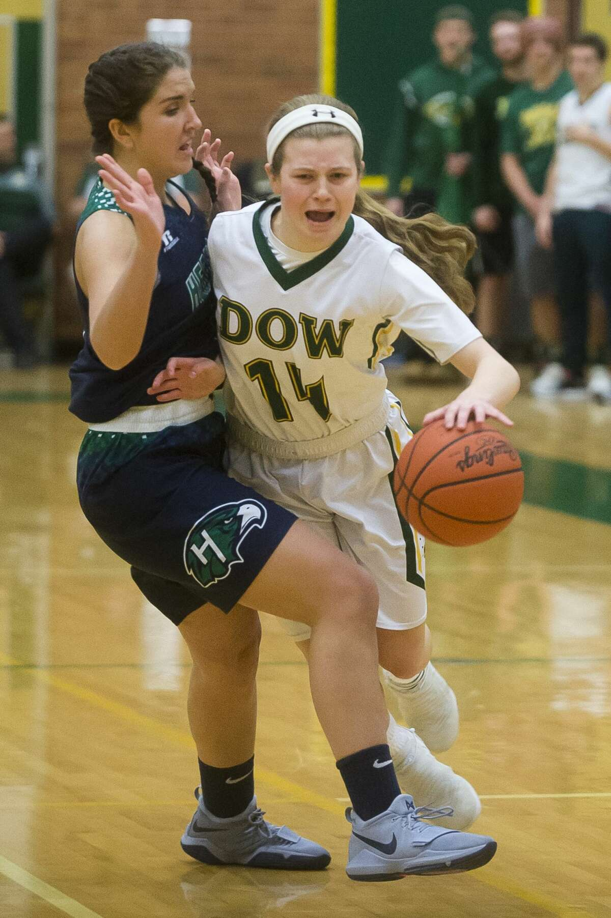 Dow junior Molly Davis dribbles toward the basket during the Chargers' game against Saginaw Heritage on Tuesday, Jan. 16, 2018 at H. H. Dow High School. (Katy Kildee/kkildee@mdn.net)