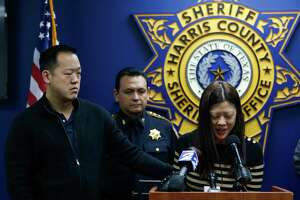 Michelle Lam is comforted by her brother, Richard Lam, as she speaks at a Tuesday press conference asking for the public's help in identifying the men who killed her parents, Bao and Jenny Lam, in an execution-style shooting in Spring on Saturday night.