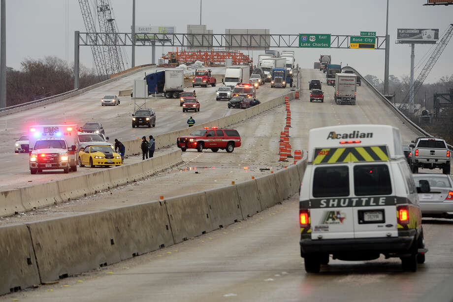 Traffic backs up after an eight car wreck in the westbound lanes of the Purple Heart Memorial Bridge on Interstate 10 on Tuesday.  Photo taken Tuesday 1/16/18 Ryan Pelham/The Enterprise Photo: Ryan Pelham / ©2017 The Beaumont Enterprise/Ryan Pelham