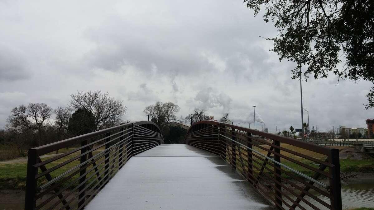 A pedestrian bridge at Memorial Park in north Pasadena goes unused as temperatures drop to a 20-year low in the Houston region.