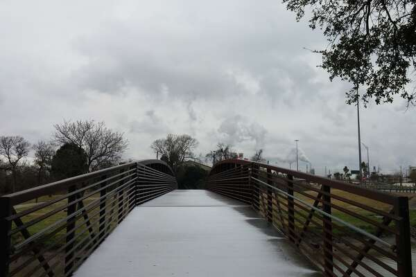 A pedestrian bridge at Memorial Park in north Pasadena goes unused as temperatures drop to a 20-year low in the Houston region.