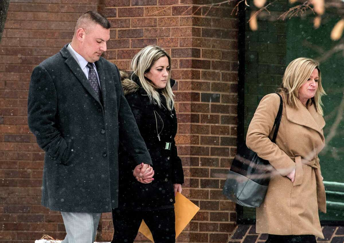 Schenectady Police Lt. Mark McCracken, left, leaves City Court with his attorney Receive Bauscher, right, and girlfriend Megan Johnson, center, after his appearance in court on Tuesday, Jan 16, 2018, in Schenectady, N.Y. (Skip Dickstein/ Times Union)