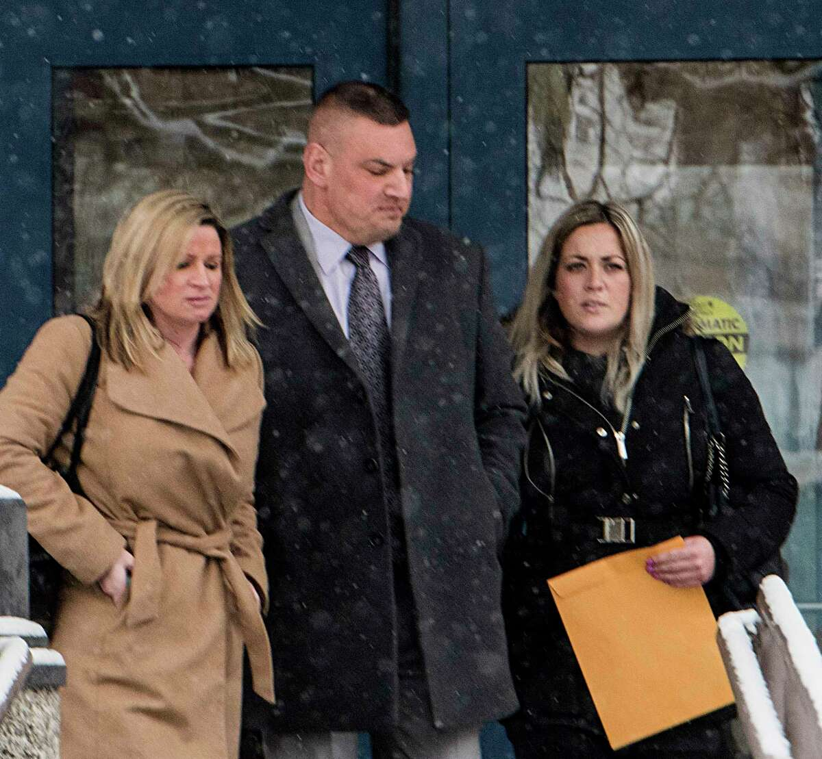 Schenectady Police Lt. Mark McCracken, center, leaves City Court with his attorney Rebecca Bauscher, left, and girlfriend Megan Johnson, right, after his appearance in court on Tuesday, Jan 16, 2018, in Schenectady, N.Y. (Skip Dickstein/ Times Union)